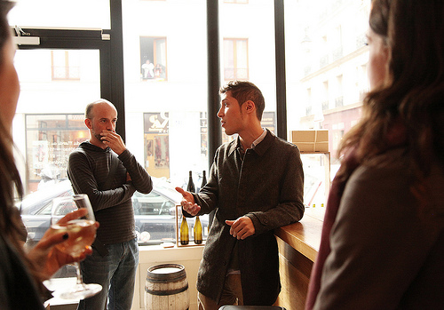 Discussing the difference between conventional & natural wine (photo Ashley Ludaescher)