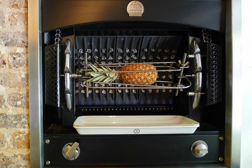 A pineapple roasting on the rotisserie at Table.