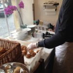 Filling cream puffs to order at La Maison du Chou