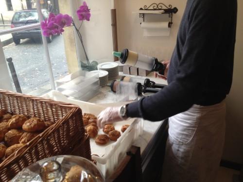 Filling cream puffs to order at La Maison du Chou| parisbymouth.com