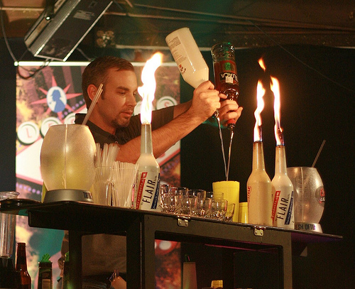 An example of the flair bartending that Colin Field believes to exist in Paris. Photo by Brandon I. via Flickr