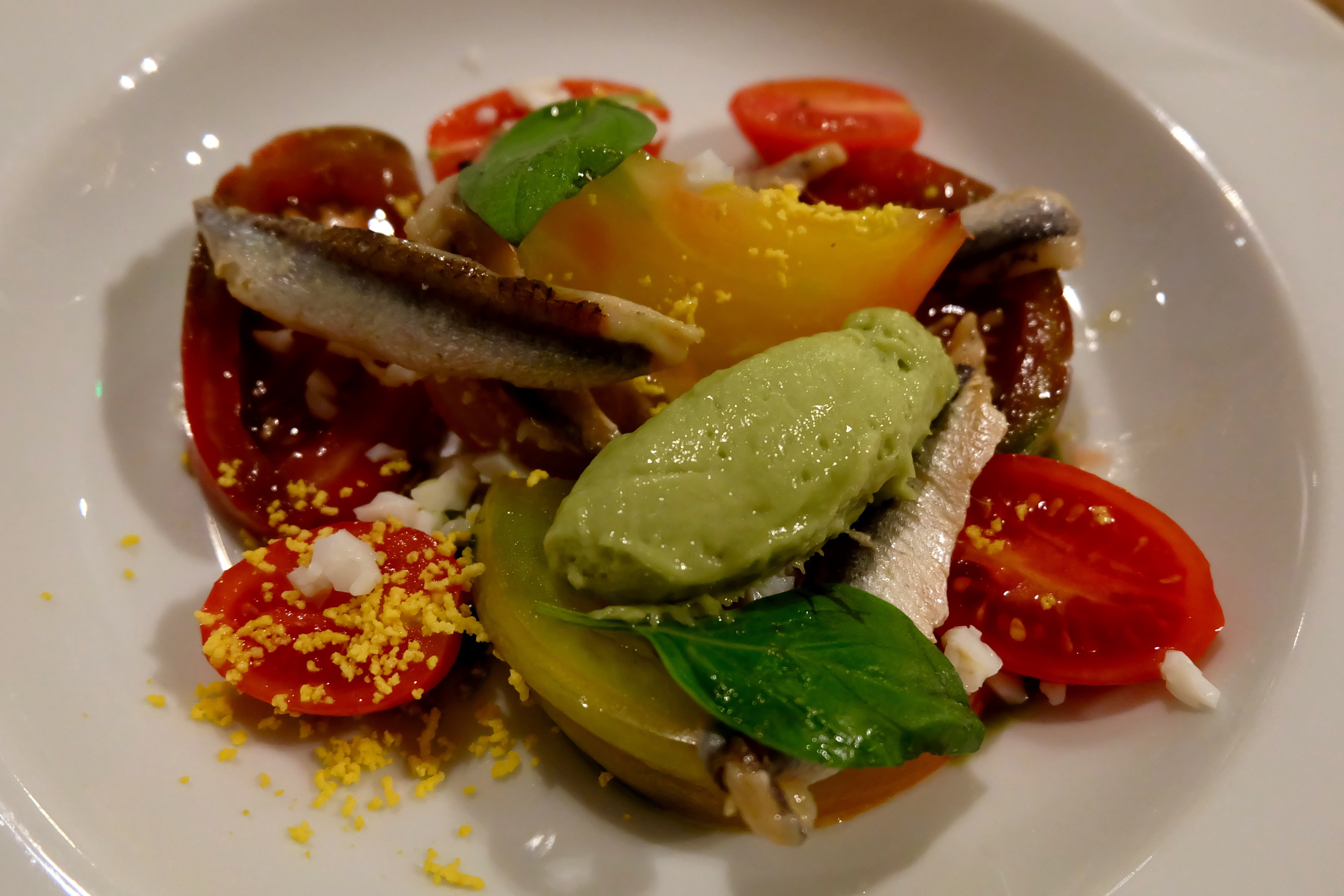 Tomatoes with basil sorbet and anchovies at Spring restaurant in Paris
