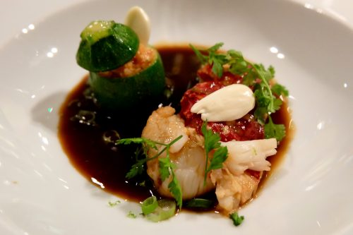Lobster with stuffed baby courgette and fresh almonds at Spring restaurant in Paris