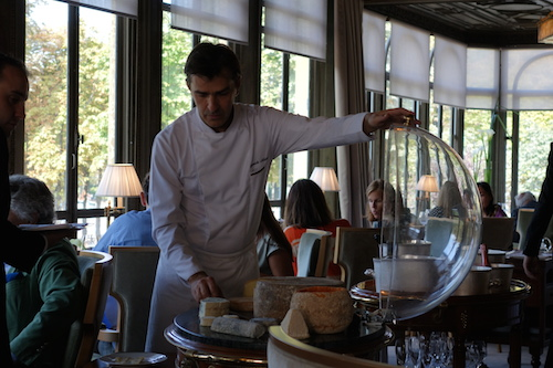 Chef Yannick Alleno personally cutting the cheese for a special table at Ledoyen