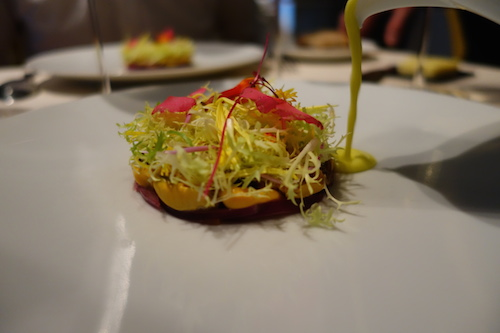 Astrance: mussels with frisée, edible flowers, lemongrass